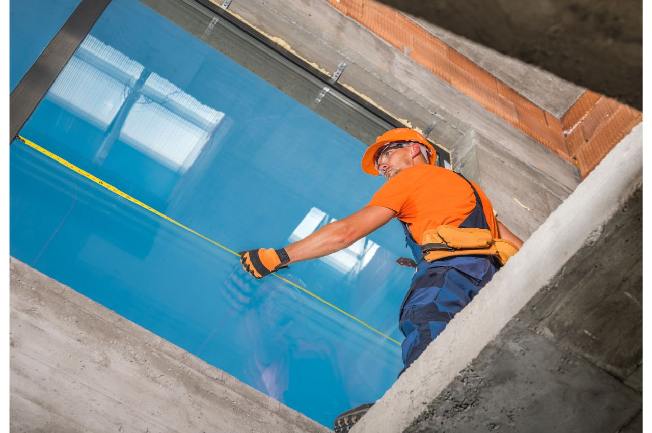 A worker about to install aluminum windows